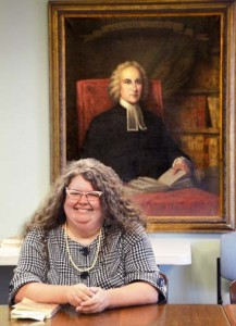 Susan Stinson with portrait of Jonathan Edwards Yale Divinity School photo credit Jeep Wheat